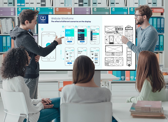 Students in a classroom discussing information displayed on a BRAVIA.