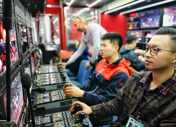 Chinese men using switchers to work on what has been filmed