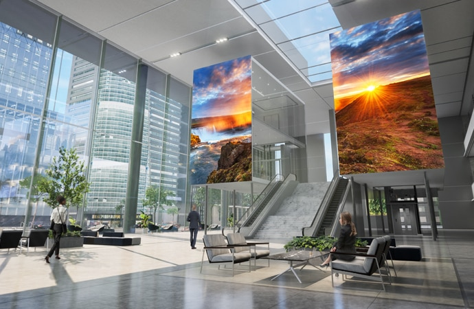 Another angle of the corporate lobby, with two large micro-LED displays displaying captivating colourful imagery.