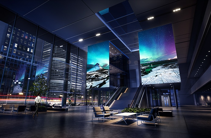 Two large micro-LED displays mounted within a corporate lobby, depicting a colourful arctic image.