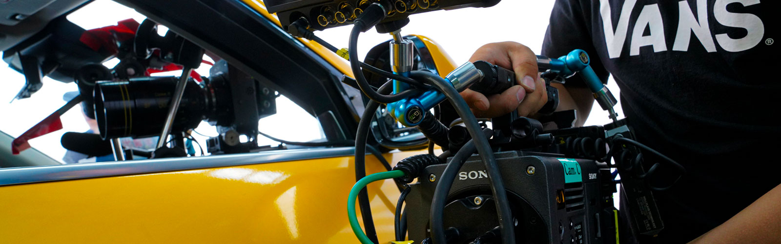 Close-up of CBK-3610XS VENICE extension kit in use for mounting on car