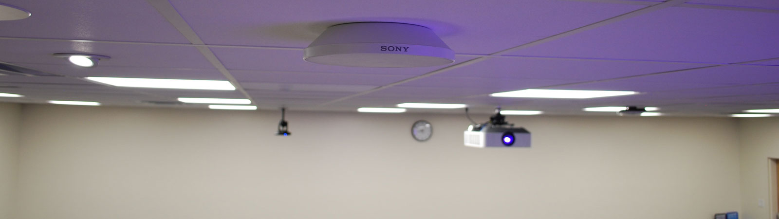 Closeup of a MAS-A100 Beamforming Microphone, mounted to the ceiling.
