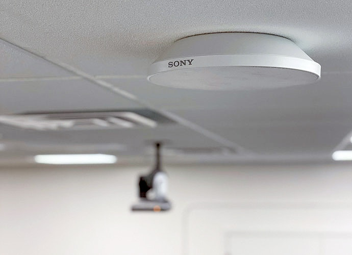 Closeup of the MAS-A100 Beamforming Microphone, mounted to the ceiling at the university.