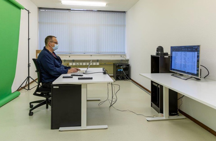 A lecturer using an online learning system in a classroom at University of Lausanne