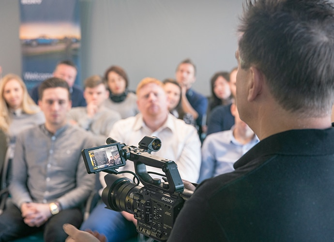 Man training his collogues with a Sony camera