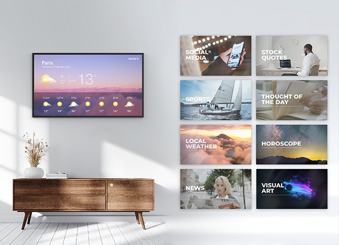 A TV mounted on the wall showing TEOS on the screen with different options of screensavers