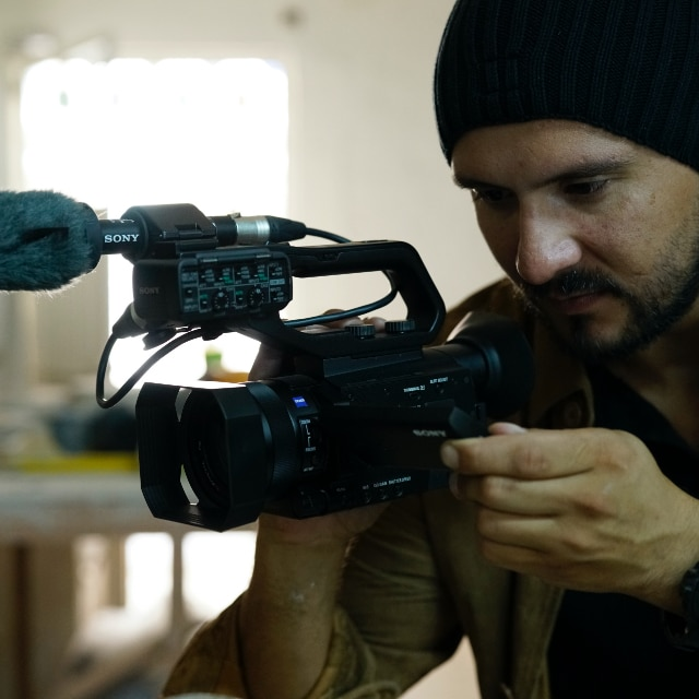 Filmmaker with PXW-Z90 on location