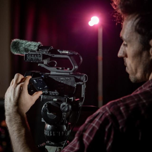 Filmmaker with PXW-Z90 in studio