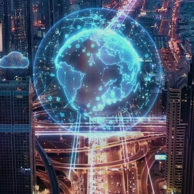 A globe above a city skyline